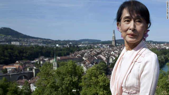 Myanmar opposition leader Aung San Suu Kyi poses in the Rose Garden in Bern on June 15, 2012 during a visit to Switzerland on her first trip to Europe since 1988. Suu Kyi will visit Switzerland, Norway, Britain, France and Ireland on her more than two-week tour, which will include a speech in Oslo to formally accept the Nobel Peace Prize that thrust her into the global limelight two decades ago. AFP PHOTO / POOL / YOSHIKO KUSANO (Photo credit should read YOSHIKO KUSANO/AFP/GettyImages)
