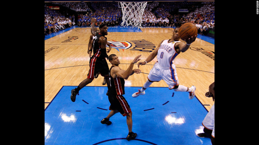 The Thunder's Russell Westbrook goes up for a shot against the Heat's Shane Battier in the first half.