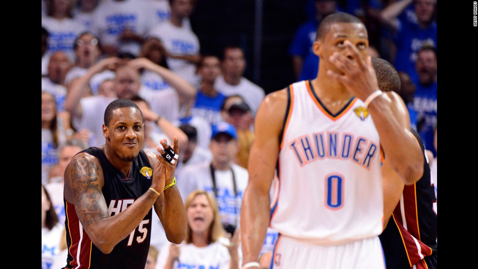 Mario Chalmers of the Miami Heat reacts behind Russell Westbrook of the Oklahoma City Thunder in the fourth quarter.