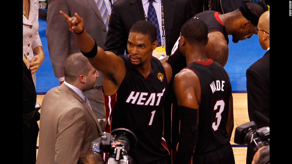 Miami's Chris Bosh, left, and Dwyane Wade celebrate the Heat's 100-96 victory over the Oklahoma City Thunder in Game 2 of the 2012 NBA Finals on Thursday.