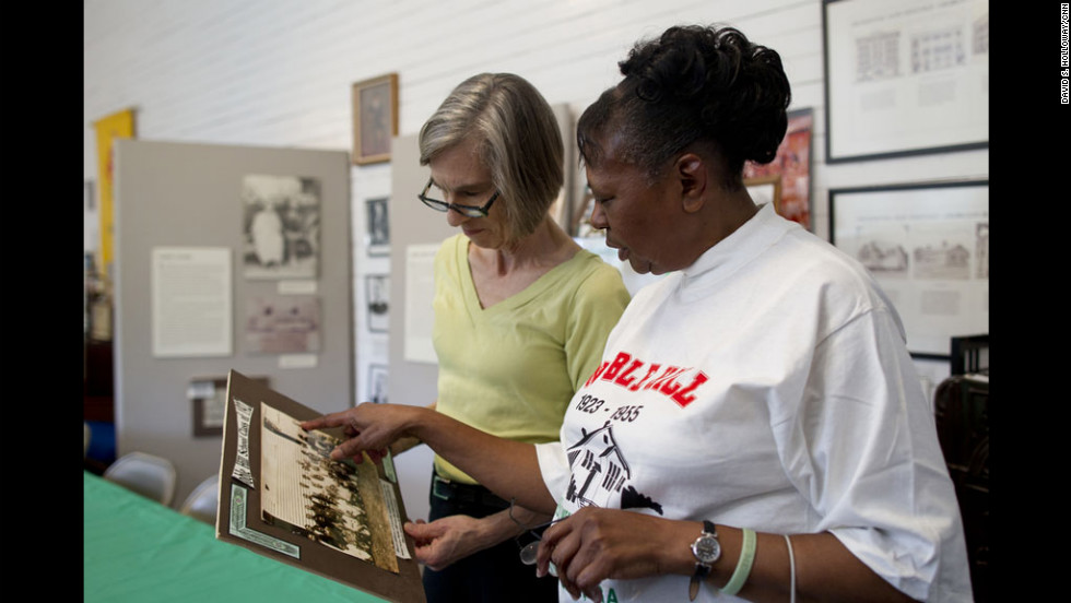 """You Need A Schoolhouse"" author Stephanie Deutsch and Noble Hill-Wheeler Memorial Center curator Marian Coleman talked during a visit to the schoolhouse museum in March. It was one of several Rosenwald schools Deutsch visited since she began to research her book about the schools."