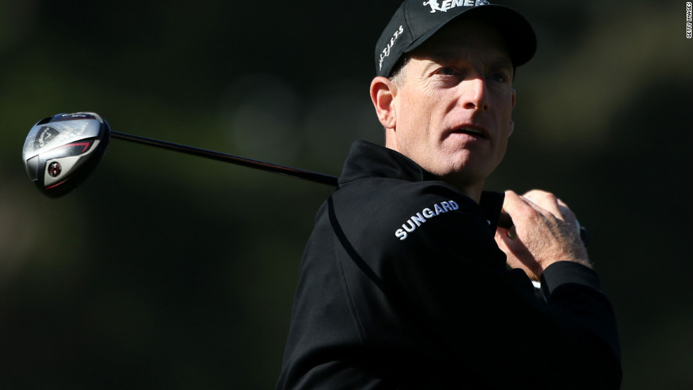 Jim Furyk of the United States watches his tee shot on the 10th hole during the second round.