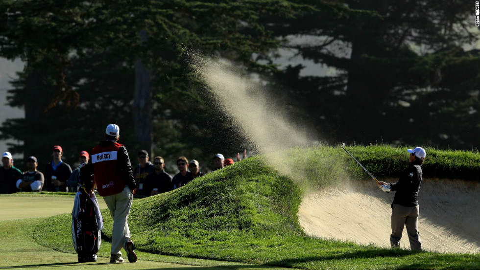 Rory McIlroy of Northern Ireland hits a shot from a bunker on the 10th hole during the second round of the 112th U.S. Open.