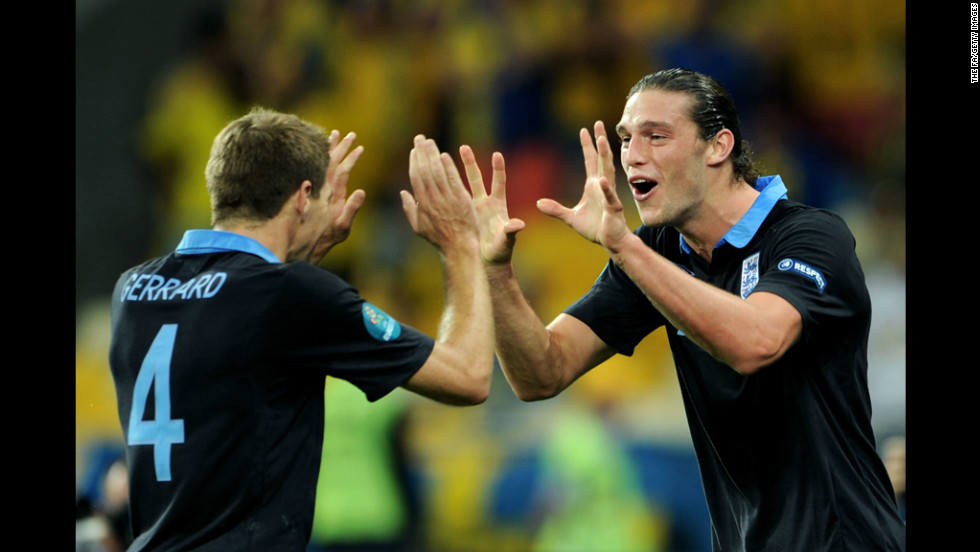 Andy Carroll, right, of England celebrates the first goal with captain Steven Gerrard during the match between Sweden and England.