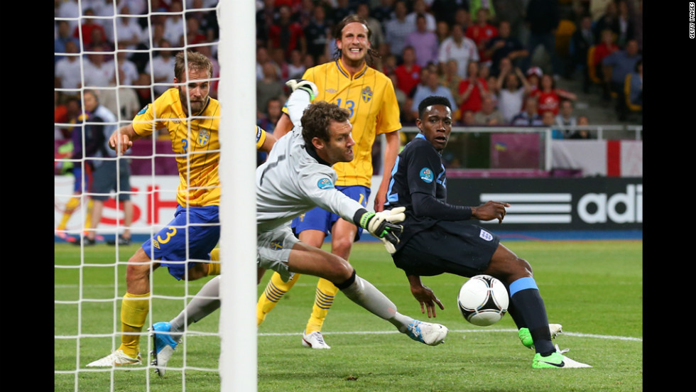 Danny Welbeck of England scores the third goal past Andreas Isaksson of Sweden.