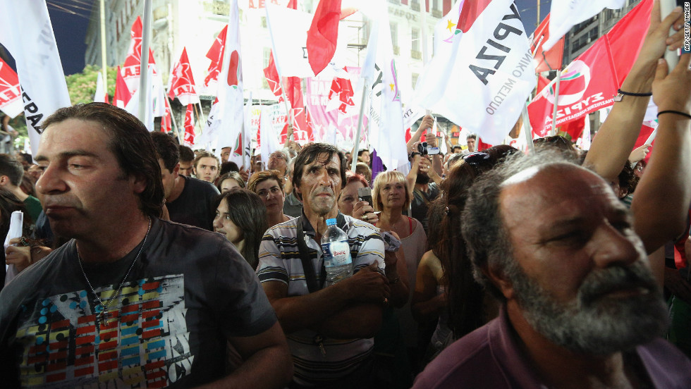 Supporters of the anti-austerity package Syriza party wave flags during a rally ahead of Sunday's general election. The race between Syriza and the pro-bailout New Democracy party appears to be tight.