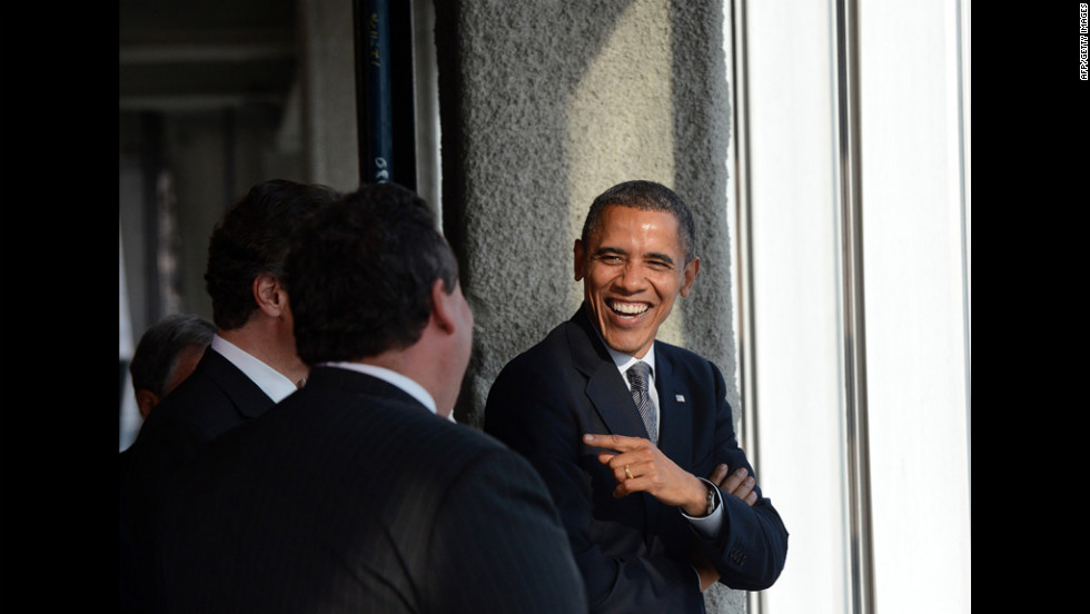 Obama laughs with Cuomo and Christie as they tour the site.