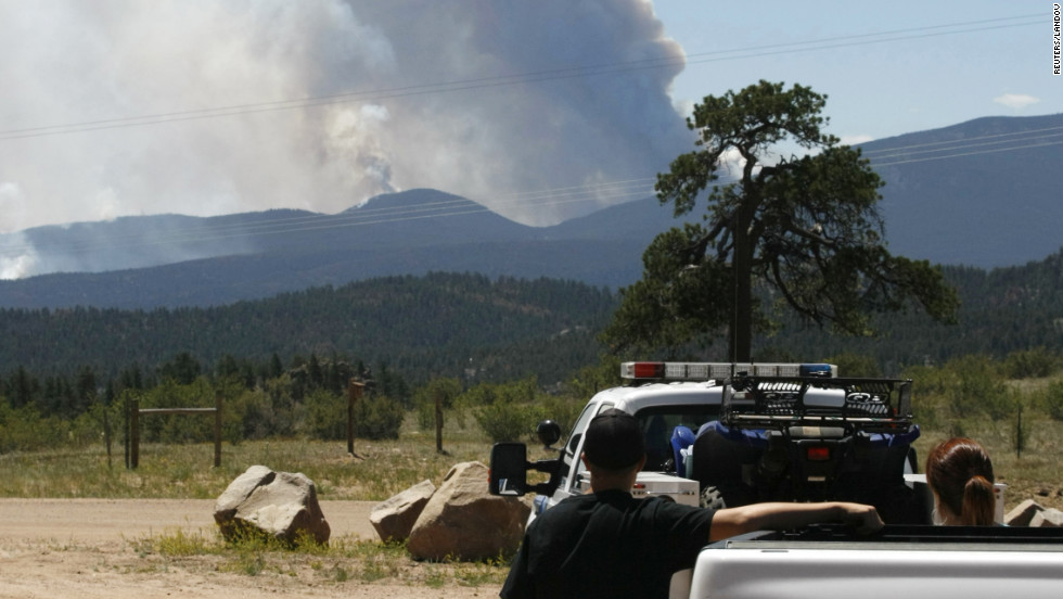 People watch smoke from the High Park Fire billow. The fire has consumed more than 50,000 acres and jumped Highway 14, prompting evacuations.