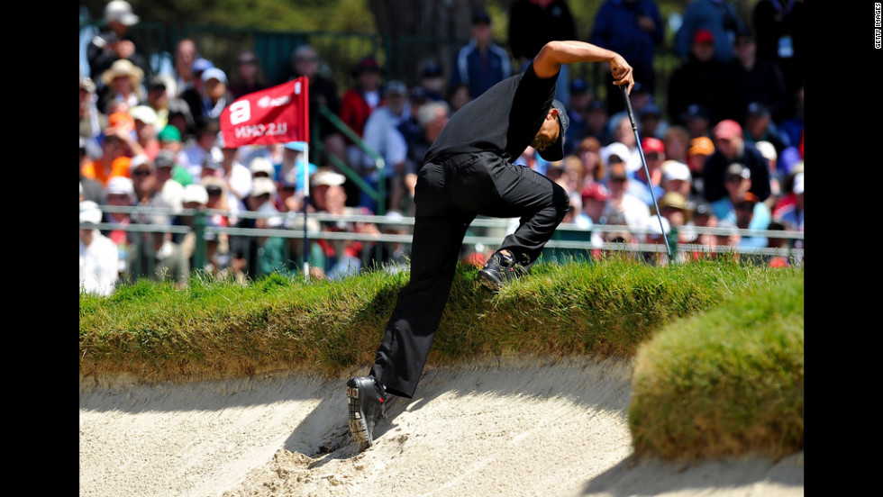 Tiger Woods climbs out of a bunker on the sixth hole during the second round.