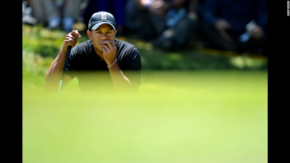 Tiger Woods of the United States lines up a putt.