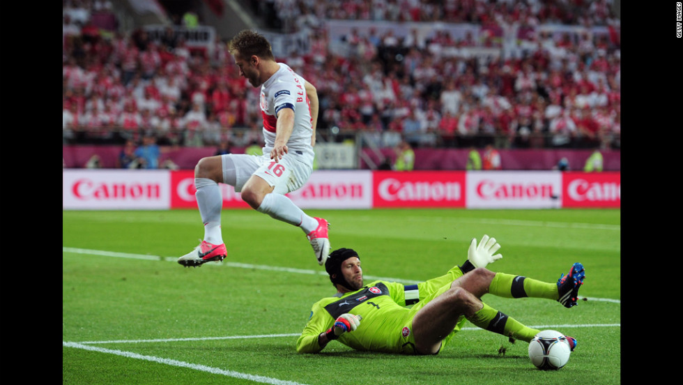 Jakub Blaszczykowski of Poland jumps to avoid a challenge from Petr Cech of Czech Republic during the match between Czech Republic and Poland.