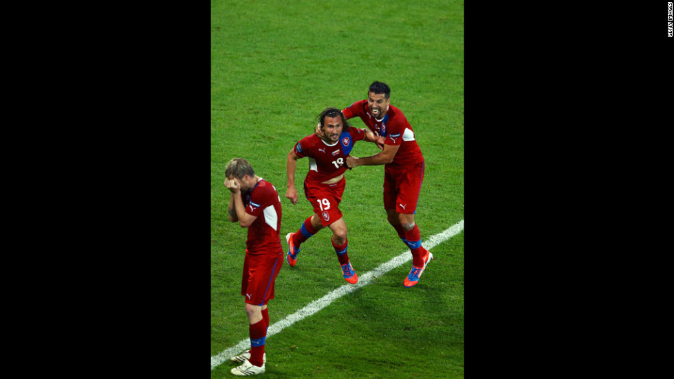 Petr Jiracek of Czech Republic celebrates scoring the first goal with Milan Baros of Czech Republic during the group A match between Czech Republic and Poland.