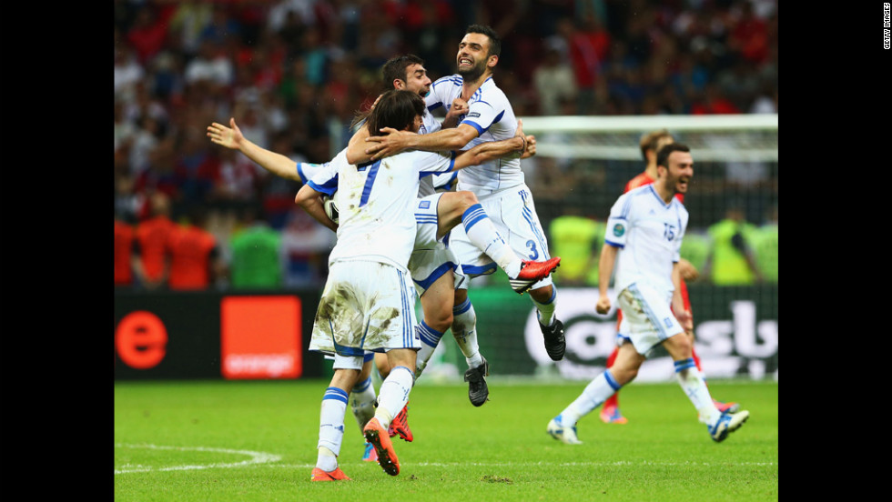 Georgios Samaras, Giannis Maniatis and Giorgos Tzavelas of Greece celebrate victory during the match between Greece and Russia on Saturday, June 16.