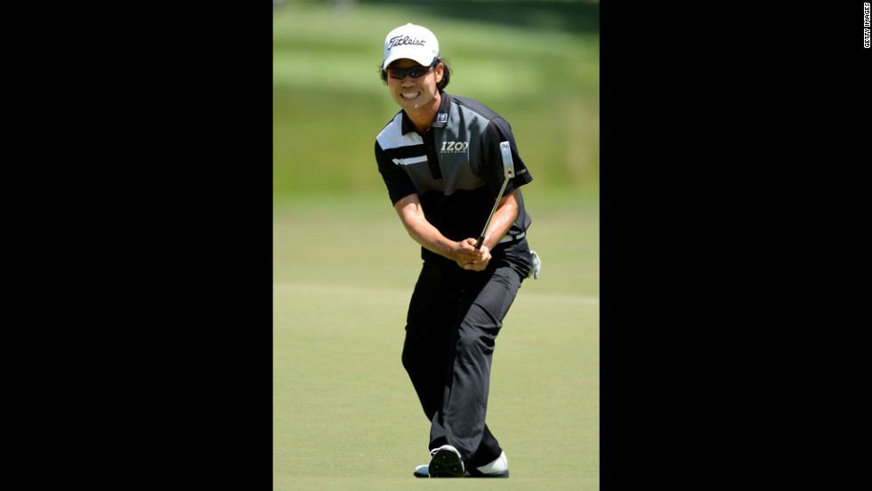 Kevin Na of the United States reacts to a missed birdie putt on the seventh hole.