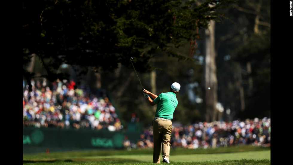 David Toms of the United States hits a shot on the fifth hole Saturday.