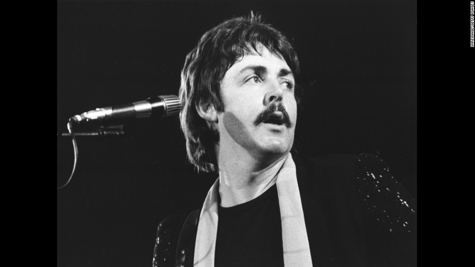 McCartney performs in 1976 with the band Wings, which he formed after The Beatles disbanded in 1970.