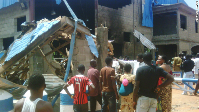 Bystanders outside Sharon Church after it was hit  by a suicide bomb attack in Kaduna, Nigeria,  on Sunday.