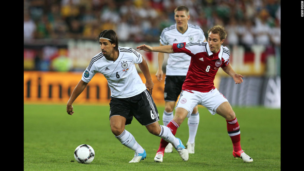 Sami Khedira of Germany and Christian Eriksen of Denmark compete for the ball.