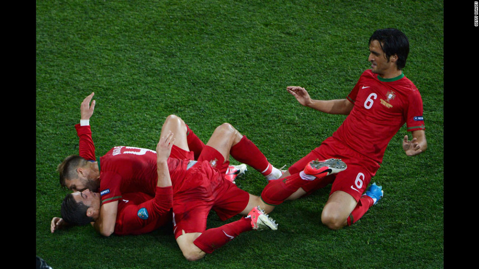 Portugal's Cristiano Ronaldo, bottom left, celebrates with teammates Miguel Veloso and Custodio after scoring the team's second goal against the Netherlands.
