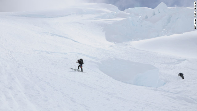 Rescuers search for missing climbers on Saturday after an avalanche on Mount McKinley.