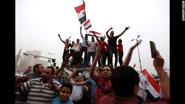 Supporters of Muslim Brotherhood candidate Mohammed Mursi wave their national flag during celebrations in Cairo's Tahrir square on June 18, 2012 after Islamists claimed victory in Egypt's first free presidential vote since its uprising. Army-backed rival Ahmed Shafiq, who served as prime minister to deposed dictator Hosni Mubarak,  disputed the announcement. AFP PHOTO / PATRICK BAZ        (Photo credit should read PATRICK BAZ/AFP/GettyImages)