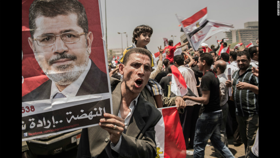 Morsi supporters rally in Cairo's Tahrir Square on Monday, June 18. Morsi declared victory as Egypt's first democratically elected president even as military rulers issued a decree that virtually stripped the position of power.