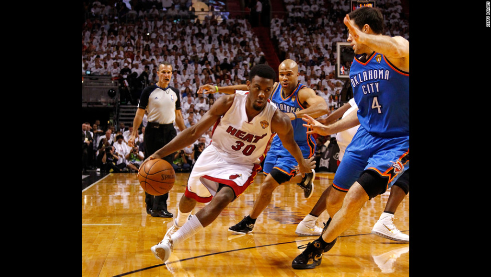 Norris Cole of the Miami Heat drives the ball during game at American Airlines Arena.