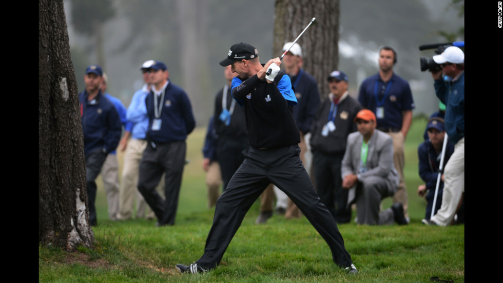 Jim Furyk of the United States reacts to a poor shot on the 12th hole.