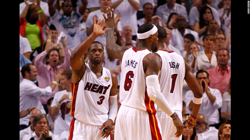 Dwyane Wade, LeBron James and Chris Bosh celebrate at the end of the second half.