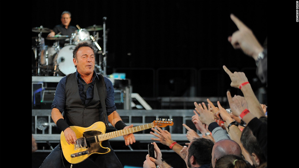 Known for his lengthy and intense concerts, Springsteen performs with the E Street Band in Barcelona, Spain, in May 2012. His concerts are marathons that can run three hours or more.