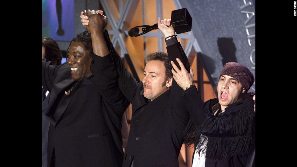 Springsteen celebrates with Clarence Clemons, left, and Steven Van Zandt of the E Street Band after being inducted into the Rock and Roll Hall of Fame at a 1999 event in New York.