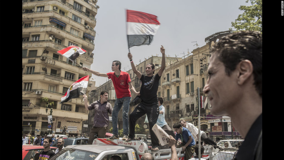 Egyptians prematurely celebrate a victory Monday for presidential candidate Mohamed Morsi in Cairo's Tahrir Square. The ruling military council cast doubt on when or whether Morsi will take office.