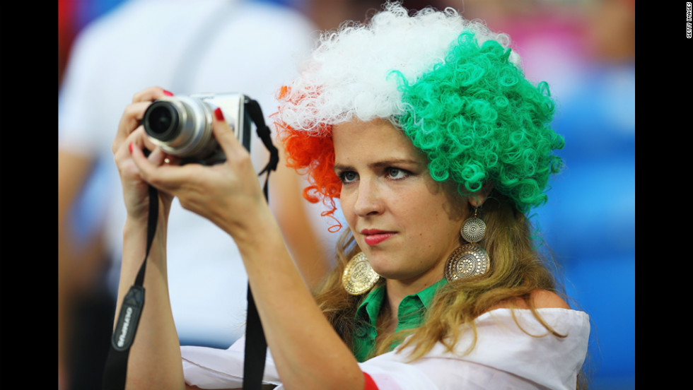 An Irish fan attempts to catch a snapshot of the action ahead of match between Italy and Ireland.