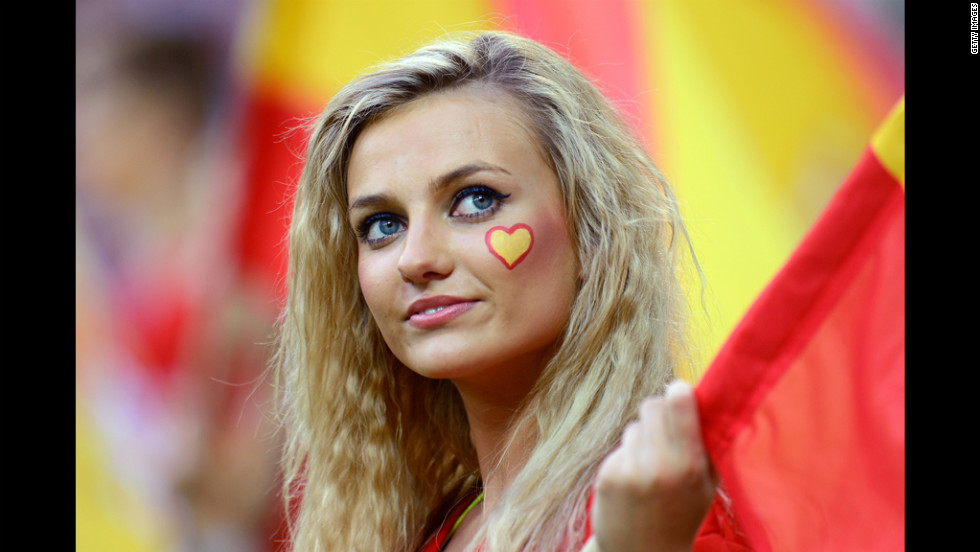 A fan awaits the action before the start of the match between Croatia and Spain.