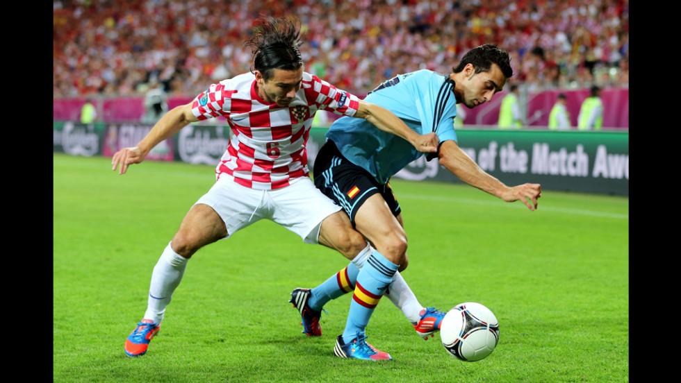 Danijel Pranjic of Croatia and Alvaro Arbeloa of Spain compete for the ball.