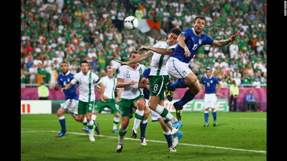 Italy's Antonio Cassano heads in the opening goal against Ireland.