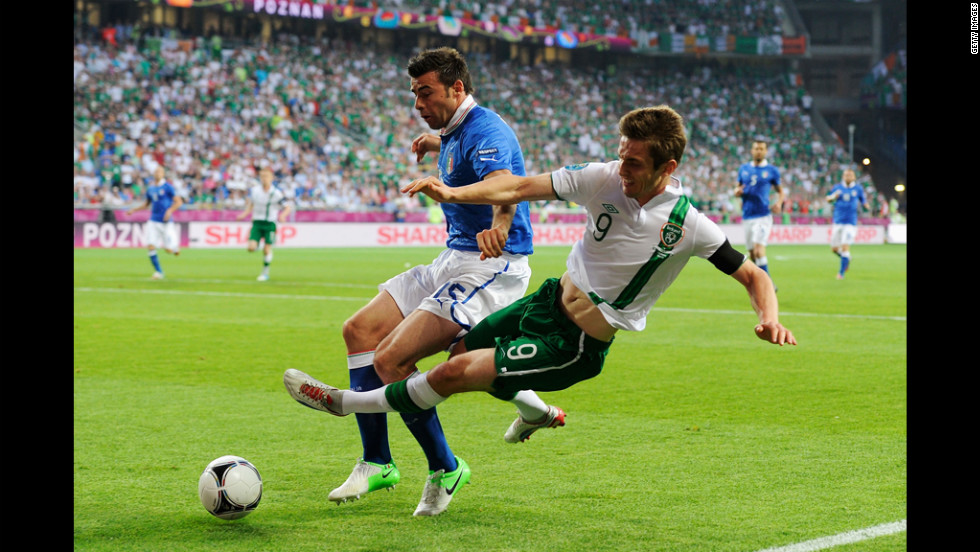 Italy's Andrea Barzagli tackles Ireland's Kevin Doyle on Monday.