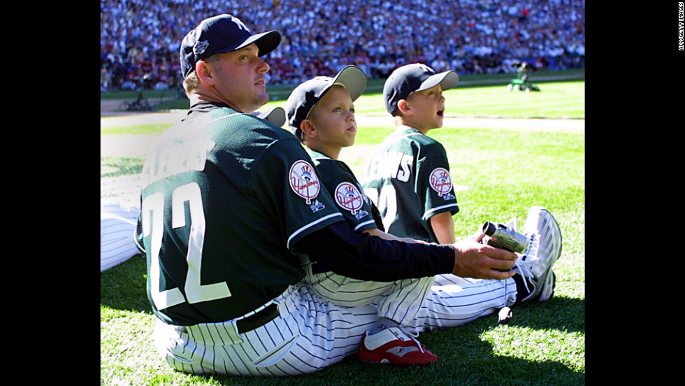 Clemens watches the 2001 Home Run Derby with his two sons at Safeco Field in Seattle.