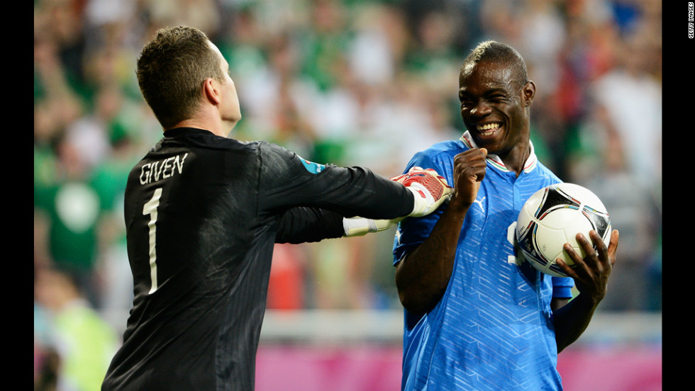 Italy's Mario Balotelli smiles at Ireland's Shay Given.