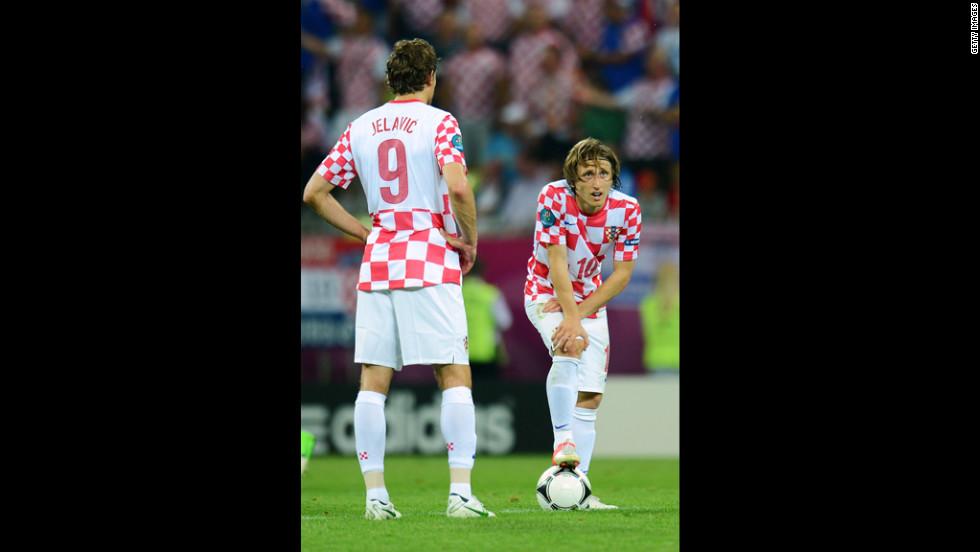 Croatia's Luka Modric looks on after Spain's Jesus Navas scores a goal.