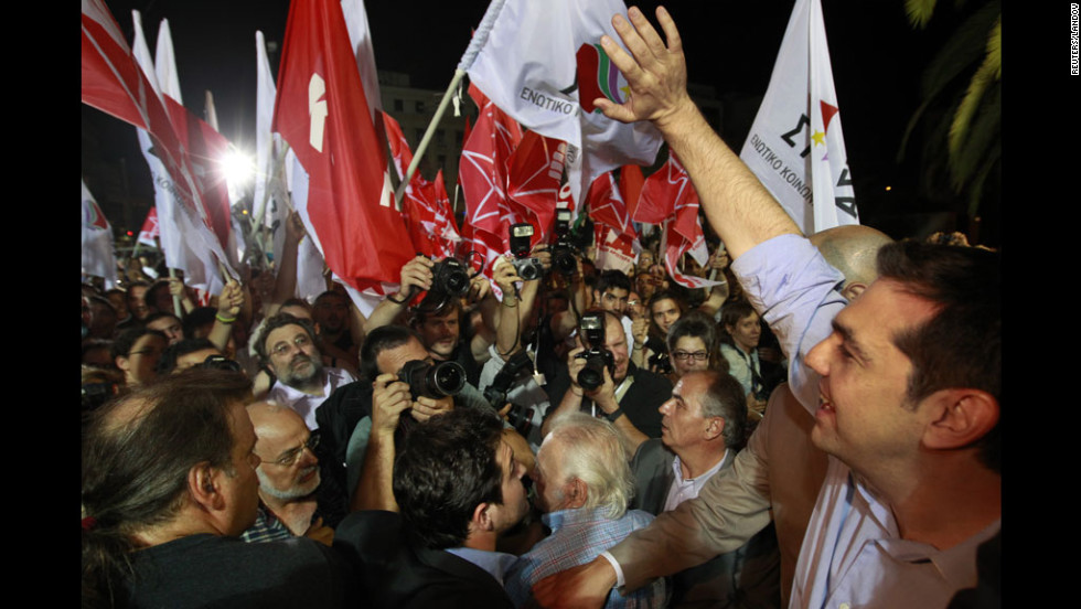 Alexis Tsipras, the head of Greece's leftist Syriza party, greets supporters after a second-place finish on Sunday. He vowed to continue fighting against restrictive European bailouts.