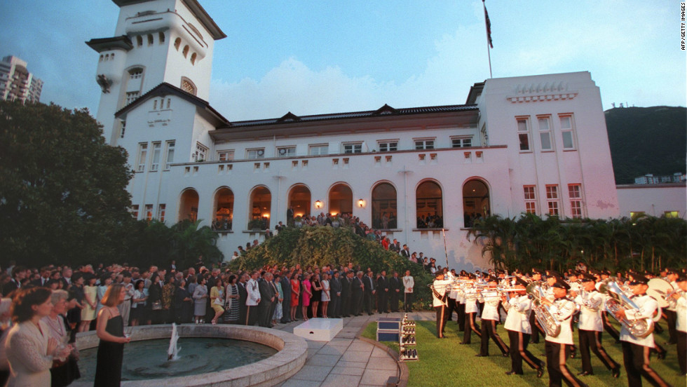 "British police troops perform in a ""Beating the Retreat"" ceremony on June 28, 1997, at Government House, the residence of outgoing Governor Chris Patten. The ceremony was also attended by Prince Charles."