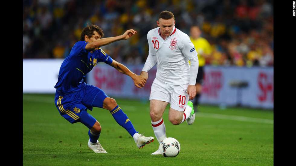Wayne Rooney of England breaks past Denys Harmash of Ukraine during Tuesday's match in Donetsk, Ukraine.