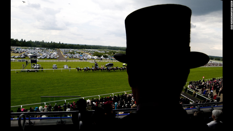 A gentleman in a tophat watches the action Tuesday during the Royal Ascot horse-racing festival at Ascot Racecourse in Berkshire, England.