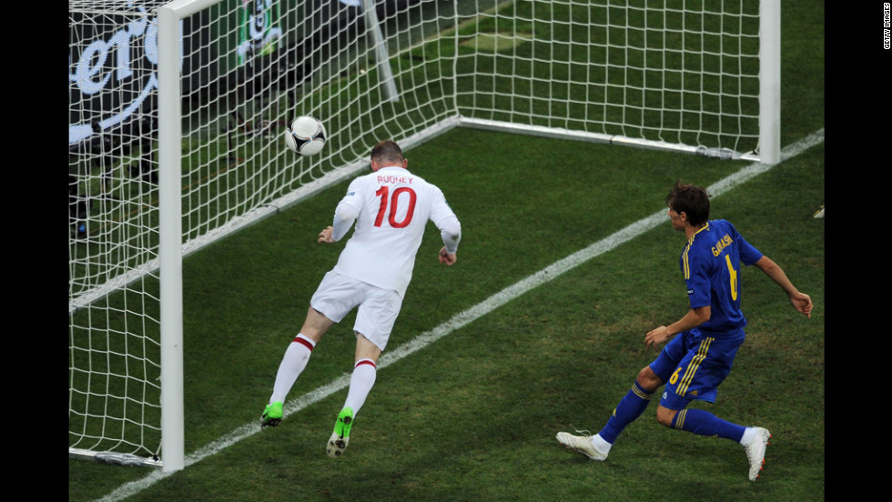 Wayne Rooney of England scores their first goal during the match between England and Ukraine on Tuesday.