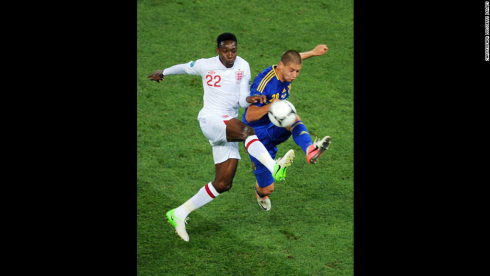 Yaroslav Rakytskyy of Ukraine and Danny Welbeck of England compete for the ball during the match between England and Ukraine.