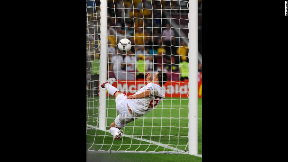 John Terry of England clears an effort from Marko Devic of Ukraine off the line during the match between England and Ukraine.