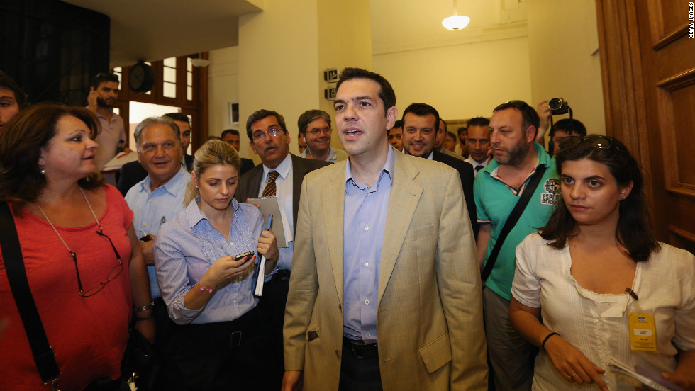 Syriza leader Alexis Tsipras walks in parliament after a meeting with New Democracy party leader Antonis Samaras.