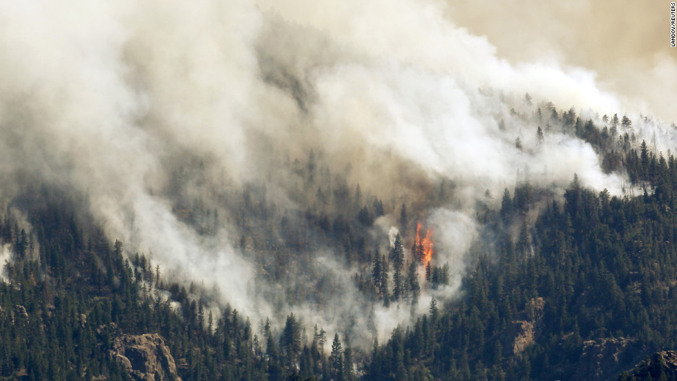 The High Park Fire rages west of Fort Collins on Monday. The blaze has ravaged more than 58,700 acres but is about 50% contained, authorities say.