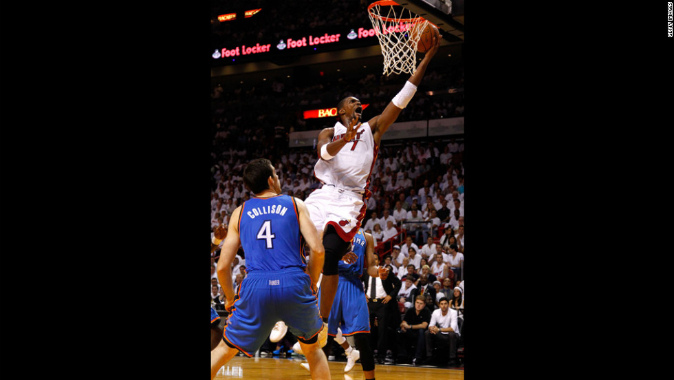 Chris Bosh, No. 1 of the Heat, drives for a shot attempt in the first quarter against Nick Collison, No. 4 of the Thunder.